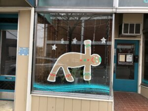 Window Decoration Gingerbread Man doing yoga. Created by one of the yoga students.